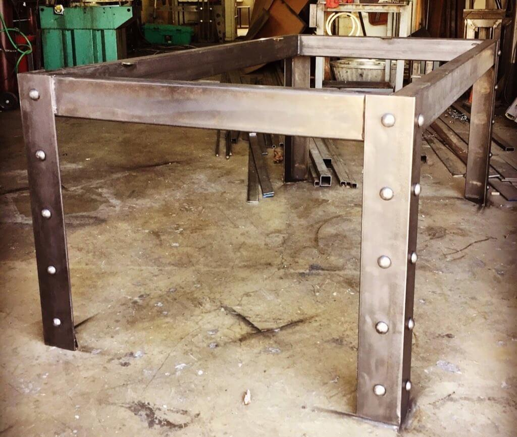 Custom industrial furniture, dining tables, table base, table legs, San Antonio furniture makers, custom hardwood tables, blacksmith San Antonio, sculptor san antonio