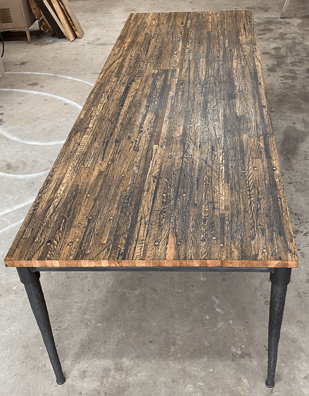 custom reclaimed wood dining table with custom table base for San Antonio client. luxury furniture San Antonio